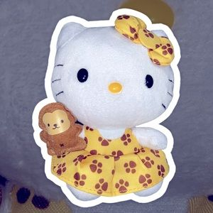 Hello kitty holding monkey plushie